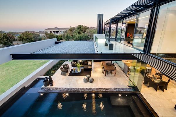 Facebook Twitter Una villa geometrica con lago privato in sudafrica ...