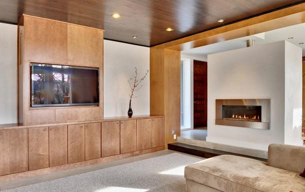 7 modi per fare convivere il caminetto e la televisione nel ... - Immagini Soggiorno Moderno Con Camino 2