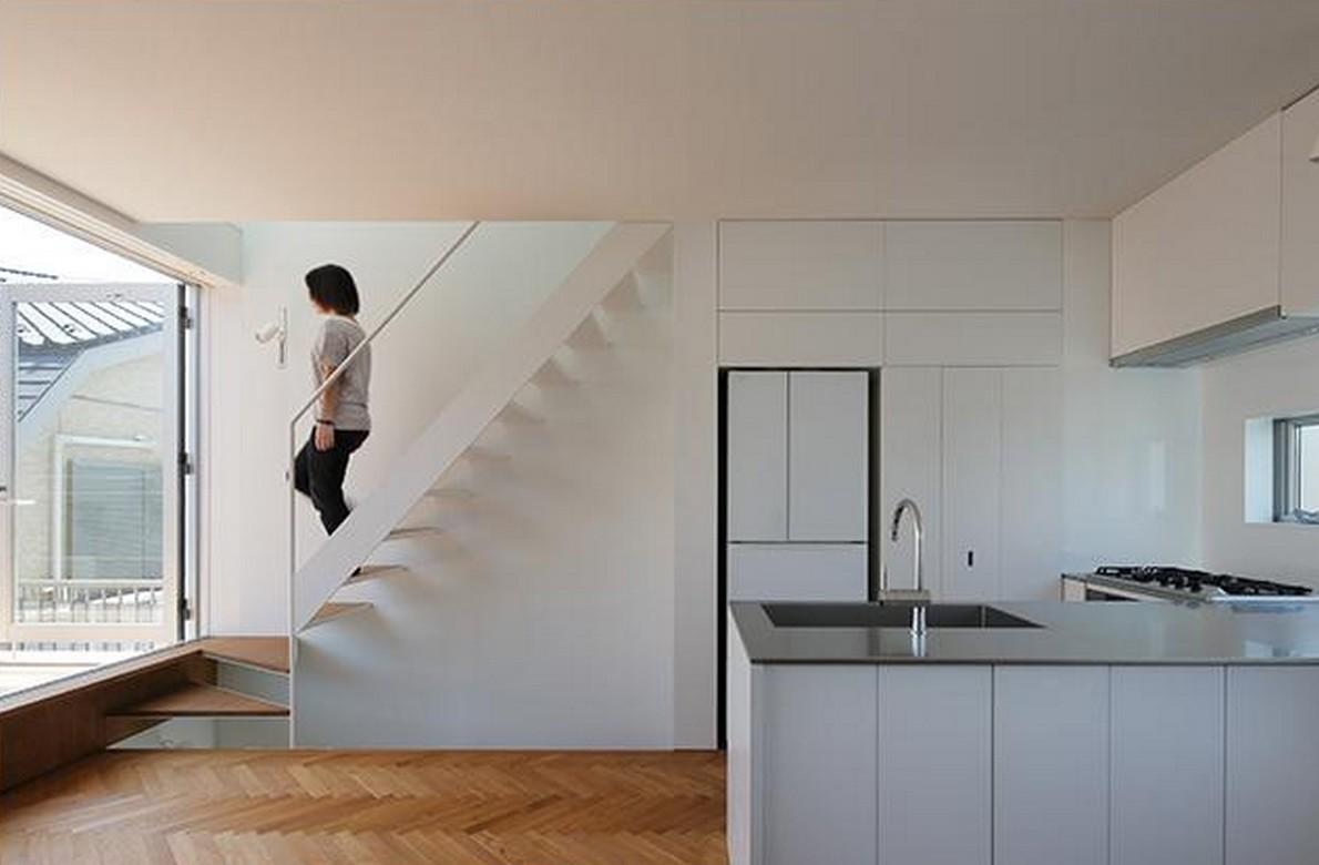Una casa in stile minimalista con una terrazza per fare for Stima sulla costruzione di una casa con 3 camere da letto