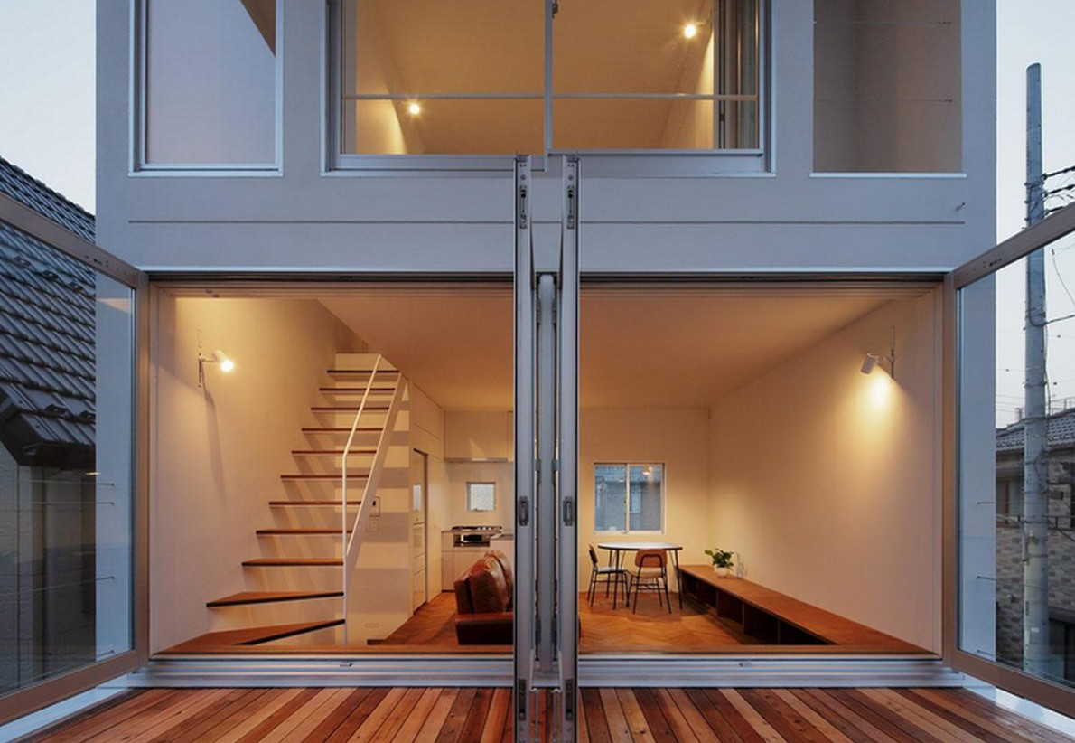 Una casa in stile minimalista con una terrazza per fare for Piccoli piani di casa con cantina e garage