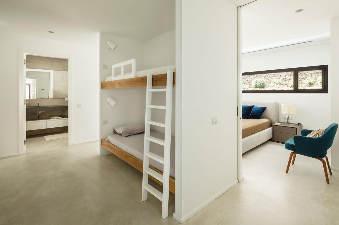 Un particolare di una camera da letto / Marcela Grassi