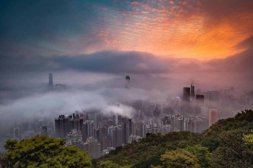 'Sunrise Glow Decorates The City In Fog'