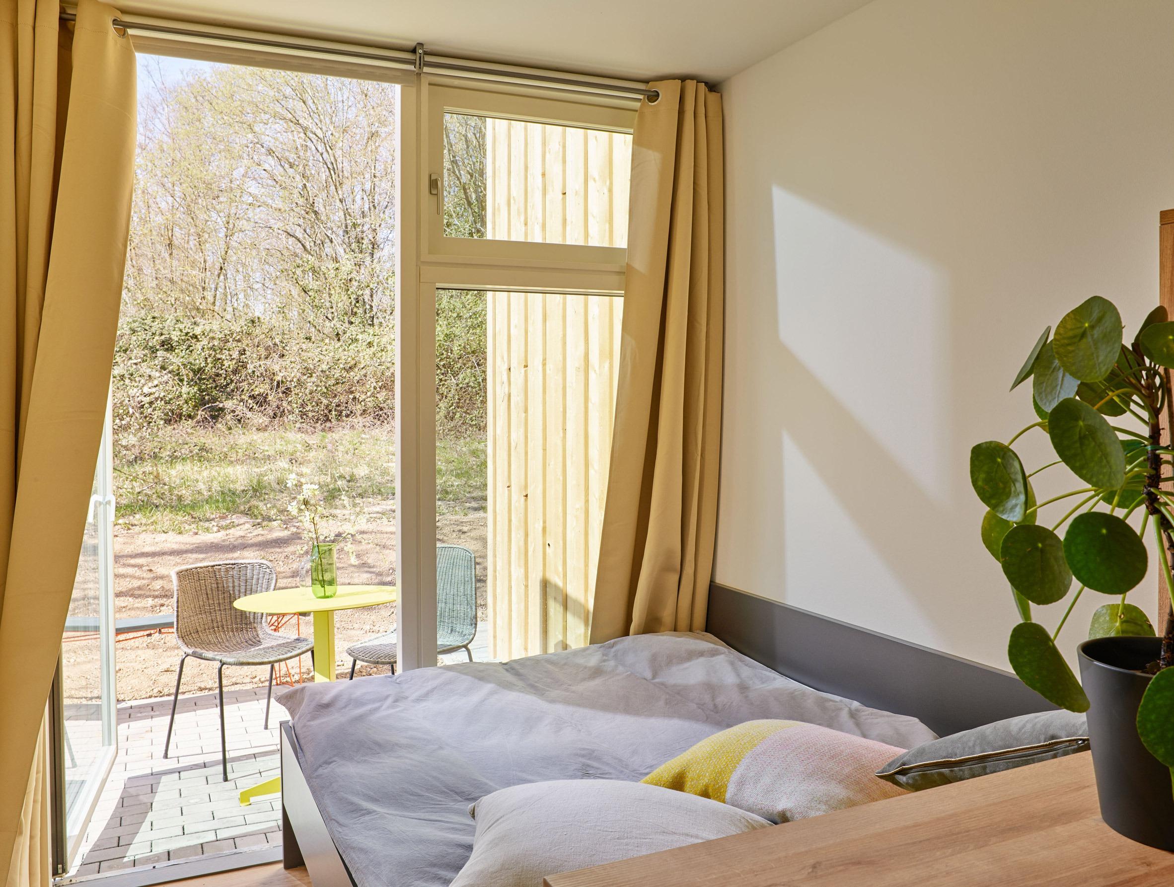 Camera da letto e terrazza / Stefan Hohloch