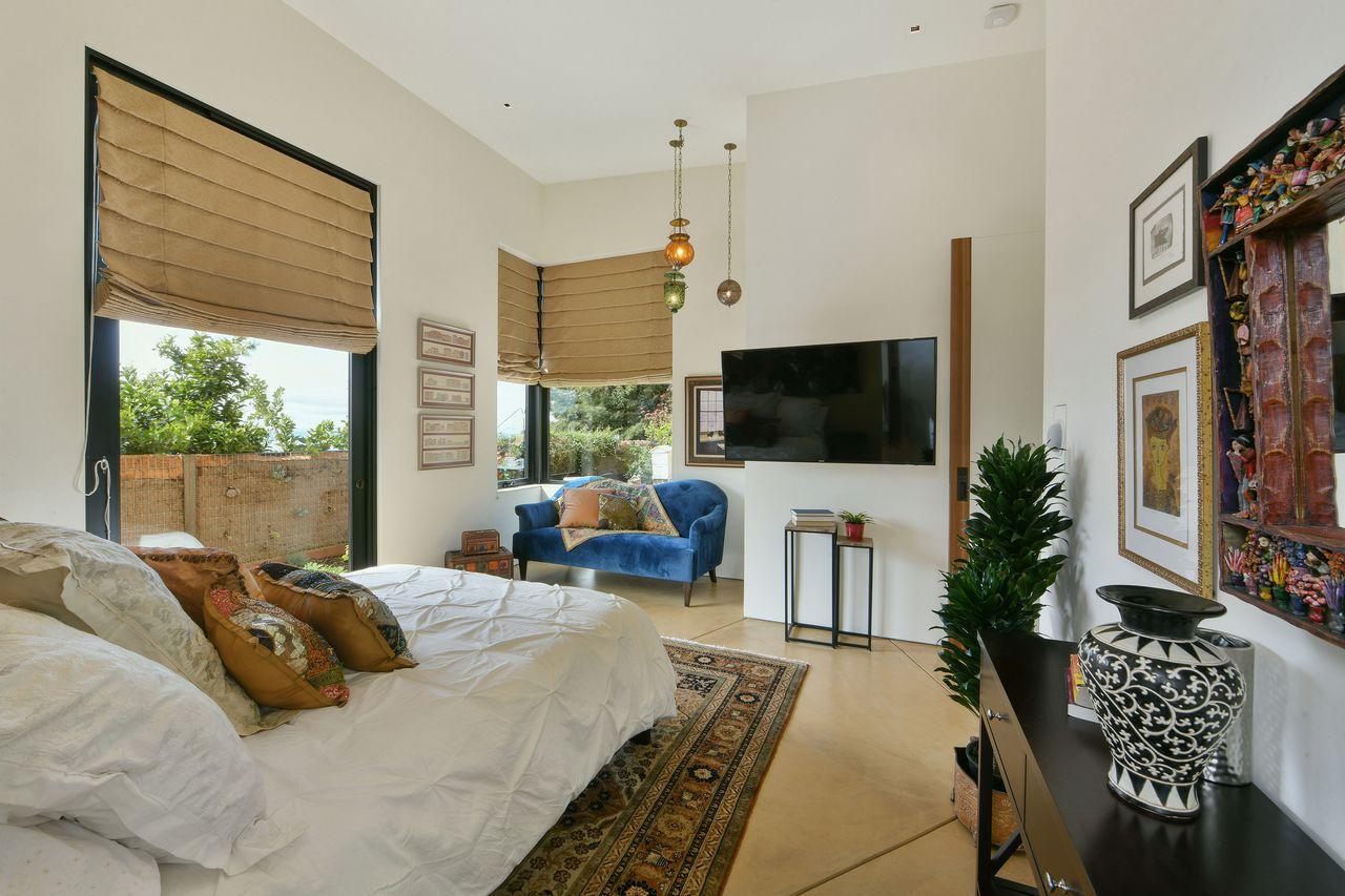La camera da letto / Open Homes Photography Inc.